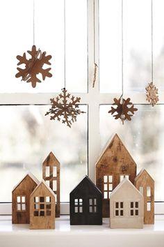 kersthuisjes en dan voor als het donker is kleine lichtjes aan erachter zodat de raampjes verlicht zijn