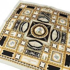 Exquisite Trimmings | Accessories | Pocket-Squares | Black and Beige Domus Aurea Pocket Square The Domus Aurea was a large landscaped portico villa built by the Emperor Nero in the heart of ancient Rome, after the great fire in A.D. 64 had cleared away the aristocratic dwellings on the slopes of the Palatine Hill. 100% Silk Colour: Black, beige and multi Handmade in Italy