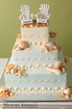 Beach for Two #31Specialty  For a well deserved wedding planner, this is the perfect relaxation cake! It's all dressed up and ready for your honeymoon. Iced in buttercream with a tint of color on each layer. The sea shells and chairs were brought in. The sand is brown sugar.