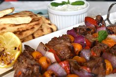 Harissa Lamb Skewers with Barbecued Flatbread and Tzatziki - Weber
