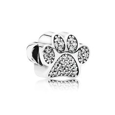 This mesmerizing sterling silver charm has been carefully crafted to resemble the cute paws of your beloved pup. With its sparkly details it will add a whimsical twist to your bracelet styling. #PANDORA #PANDORAcharm