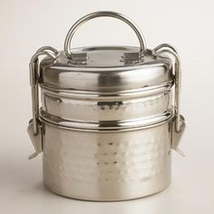 Our stylish Hammered Metal Tiffin Lunch Box is crafted in India with multiple compartments secured by a latched lid. Its lasting durability and ample space make this unique Indian-style lunch box ideal for potlucks, picnics and camping trips.