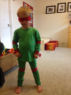 Ninja Turtle with green long underwear and strips of red material