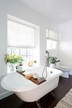 Bathroom envy. Freestanding claw foot bathtub, large window, minimal bathroom