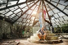 Picture of Man sitting in ruined greenhouse in Botanical garden, Puducherry, India stock photo, images and stock photography. Man Sitting, Glass Domes, Botanical Gardens, Patio, Stock Photos, Greenhouses, Conservatory, Equestrian, Pictures