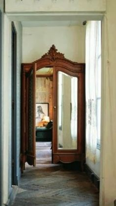 Old wardrobe closet doors repurposed as actual doors! Great idea for a dressing room.