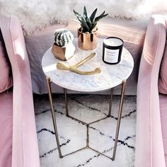 #ScreenshotandChill with the magnificent afternoon light reflecting off the rose gold decor and pink accent chairs 😍💕 What's your favorite spot in your house to wind down? ||  Shop this pic via screenshot with the new LIKEtoKNOW.it app OR click on the link in my bio || http://liketk.it/2qLnk #liketkit @liketoknow.it @liketoknow.it.home #LTKHome