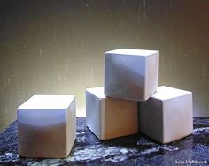This is a cuboid shaped paperweight. There are 4 pictured. This listing is for ONE paperweight. Some have more air bubble holes than others. That is the nature of this cement. Cement, Concrete, Slumped Glass, Coin Jewelry, Glass Etching, Paper Weights, Wall Tiles, Planter Pots, Bubbles