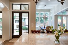 Transitional Kitchen by Frankel Building Group