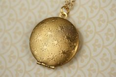 Textured Stars Locket Necklace, Round Pendant, Long Gold Chain, Raised Starry Pattern Design