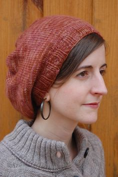 "Parisian Slouch Hat Find more pattern info at:   Needles: Size 8 double pointed needles (4) Size 8 circular needles,16"" Gauge: 2 inches stockinette = 10 st/14 row Yarn: Worsted weight wool -- I use..."