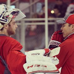 Photo by washingtoncaps - Caps goalie Braden Holtby talks with head coach Adam Oates
