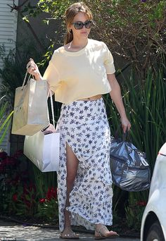 Summer style: Hunger Games star Jennifer Lawrence left a celebrity event in Los Angeles on Sunday with bags of free designer gifts in tow