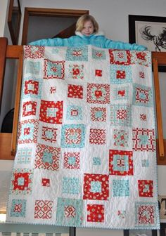 "Red and aqua Christmas quilt. I like that it's not super ""Christmasey"""