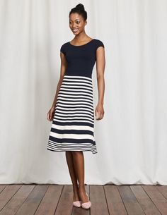 This dress perfects Riviera style, whether you're strolling around a city or relaxing on the beach. It's ultra-feminine and oh-so flattering with a fit-and-flare shape and boat neckline. Stripes around the skirt make it mesmerising to swish. Team with wedges for dinner, and sandals for walks along the coast.