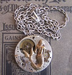 Steampunk necklace watch parts Mermaid jewelry gears vintage watch industrial. $75.00, via Etsy.