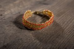 Bracelet made of glass beads in gold and red colours - beadwork, beaded, embroidered, beading,