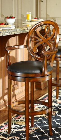 Our Kristina Barstool is a favorite when it comes to bar furniture. These beautifully handcarved stools boast the substantial, high-quality construction you might expect from fine dining chairs.
