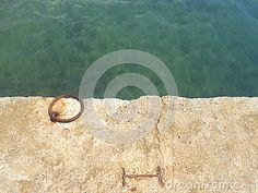 Teal Waters And An Iron Ring In A Dock - Download From Over 25 Million High Quality Stock Photos, Images, Vectors. Sign up for FREE today. Image: 43854856