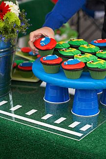 Great DIY tailgaiting decor: turf table topper, turf koozie,& paper towel holder!