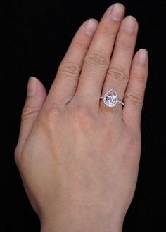 14K White Gold Pear Cut Morganite Engagement Ring Shape Diamond Halo Alternative Engagement Solitaire Wedding Anniversary Gemstone Ring. $1,100.00, via Etsy.