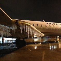 A very iced & frozen United Airlines Aircraft