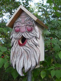 Santa birdhouse, wood carvings,folk art primitives Santa with glasses bird house