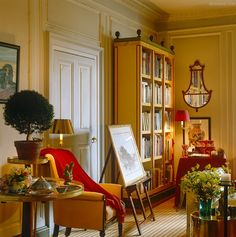 Red chaise colorful art books a pug john stefanidis for John stefanidis interior design
