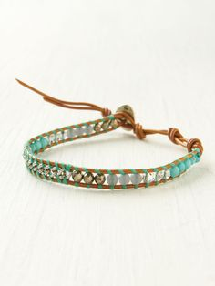 Woven leather bracelet with bead and chainlink detailing and adjustable closure. diy tutorial done with pearls
