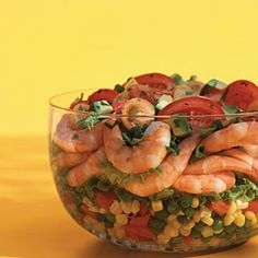 This is packed with protein—and flavor. Use a clear bowl to show off the appetizing layers of plump corn, green peas, bell pepper, avocado and tomatoes, which are topped off with a lively lemon vinaigrette 508 CAL Pea Salad Recipes, Healthy Salad Recipes, Savory Salads, Healthy Meals, Healthy Food, Snack Recipes, Yummy Food, Seafood Dishes, Seafood Recipes