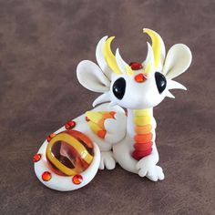 White-and-Orange-Dragon-Sculpture-by-Dragons-and-Beasties