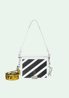"White flap bag with black diagonals.      Height 17cm.  Width 19 cm.  Depth 10 cm.  Width shoulder strap 7 cm.  Length ""TIE DOWN"" shoulder strap 162 cm."