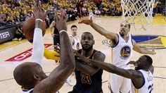 Cleveland vs Golden State action with Le Bron James going to the basket with 3 Golden State on him