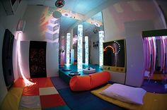 Pretty standard Snoezelen therapy room.  Nice set up with padded textures and different lighting sources!