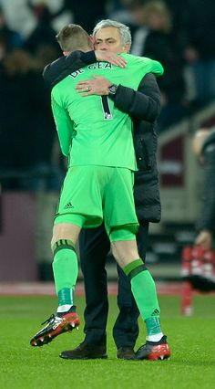 David De Gea of Manchester United gets a hug from manager Jose Mourinho following the Premier League match between West Ham United and Manchester...