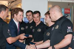HRH Prince Harry giving Neil Heritage of Row 2 Recovery his Atlantic medal