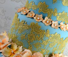 The Eternity 3D Cake Lace mat by Claire Bowman incorporates flowers, buds and embroidery into this nature inspired lace design. The 3-part mat for creating edible lace is perfect for use on several tiered cakes to really showcase the mats detail and create a stunning cake! Featuring Cake Lace's UNIQUE 3D design for edible cake lace that looks just like real lace!