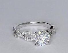 Wow... oui, je la veux!!! Ma bague de rêve, mais avec un diamant carré. Qui veut faire suivre à mon chum!?!?!?