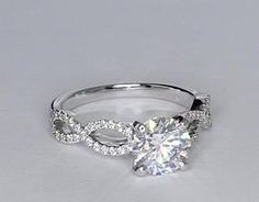 In LOVE with this ring! -- Infinity Twist Diamond Engagement Ring