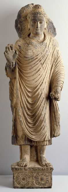 Image from http://iers.grial.eu/modules/introduction/budismi/images/standing_buddha_4477564_560x1568.jpg.