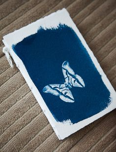 handmade journal with cyanotype of moth by ericmbaral on Etsy, $10.00