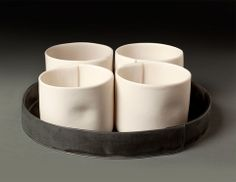 This diminutive set of 4 cups is hand built from cone 6 porcelain slabs, twice fired in oxidation with a semi matte glaze Food, dishwasher and microwave safe Complements Wrapped Teapot Made to orde click now for info. Slab Pottery, Pottery Mugs, Ceramic Pottery, Porcelain Dinnerware, Porcelain Ceramics, Painted Porcelain, Fine Porcelain, Ceramic Bowls, Ceramic Art