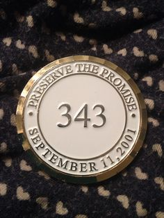 My challenge coin from the fire department. We will remember, 343.