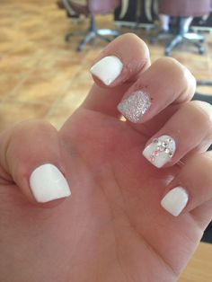 I'm so in love with my nails for prom  #white #rhinestones #cross