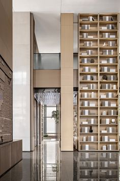 ONE-CU Interior Design Lab designed the Wang Jing Mansion Sales Center in Shenyang, China. Dental Office Design, Modern Office Design, Modern Interior Design, Modern Offices, Healthcare Design, Lobby Interior, Luxury Homes Interior, Japanese Restaurant Design, Glass Curtain Wall