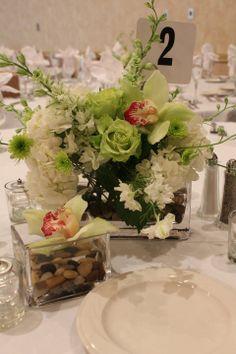 Green orchid mix wedding centerpiece