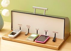 Convert an old bread box into a charging station for your most used electronics! Drill a hole into the back of the bread box and thread the power-strip cord through. Use fiberboard or white cardboard to create the divider and you're ready to charge your devices!