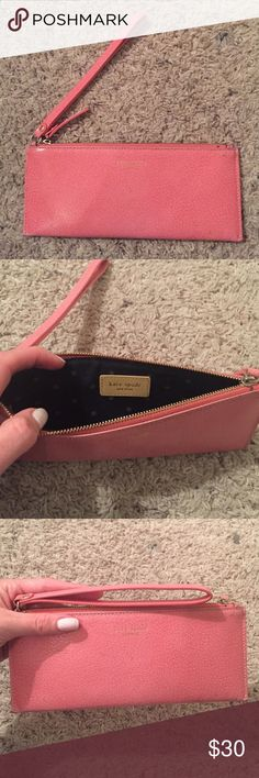 Kate spade wristlet Pink Kate spade wristlet that shows some signs of wear (as shown in photos)... But overall in great condition! kate spade Bags Clutches & Wristlets