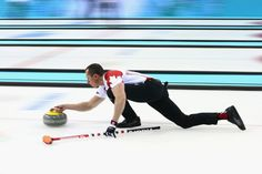 E.J. Harnden E.J Harnden of Canada in action during the round robin match against Germany during day 3 of the Sochi 2014 Winter Olympics at Ice Cube Curling Center on February 10, 2014 in Sochi, Russia.