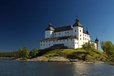 Läckö Slott is a towering fairytale-like castle reflected in the waters of Lake Vänern.